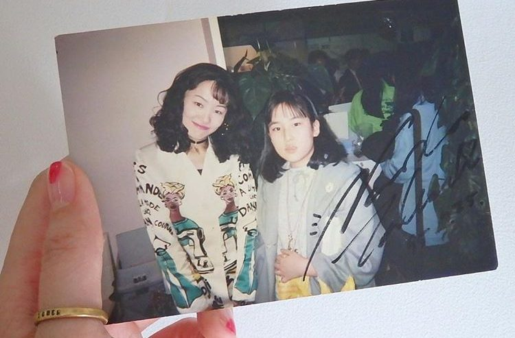 A young fan poses with Naoko Takeuchi in 1994