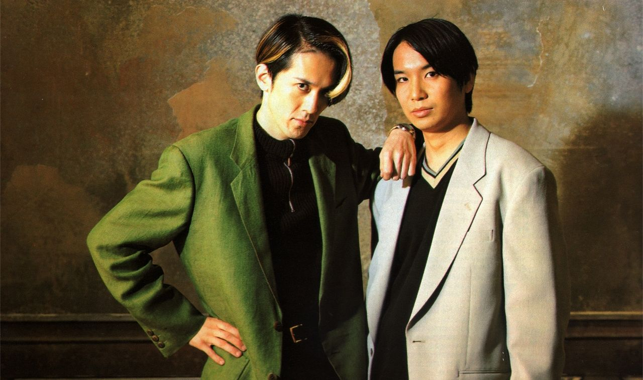 "Ikuhara (left) trying the ""zero-fashion-sense Mamoru"" look"