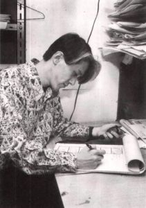 Director Kunihiko Ikuhara hard at work on a storyboard while wearing a funky shirt